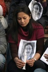 A protester holds a photo of Uma Singh. (Reuters)