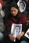 A protester holds a photo of Uma Singh. (Reuters)
